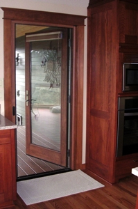 Above: Is An Outswing Door Fitted With Our Wood Grain Finish Single Door  Screen System.